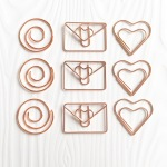 Rose gold spiral envelope and heart paperclips