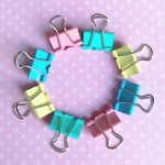 Pastel green blue pink and yellow binder clips